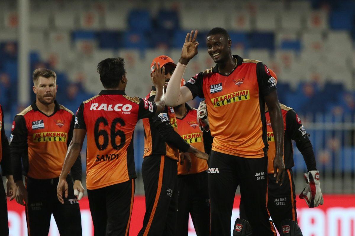Jason Holder is mobbed by his team-mates, Sunrisers Hyderabad vs Punjab Kings, IPL 2021, Sharjah, September 25, 2021