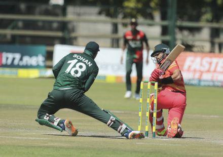 Nurul Hasan tries to stop the ball off Sikandar Raza's sweep
