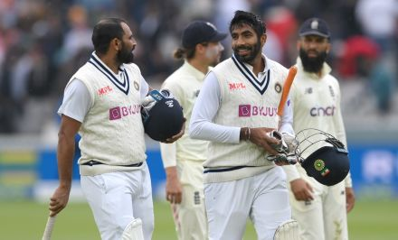 Mohammed Shami and Jasprit Bumrah leave the field after putting India in front