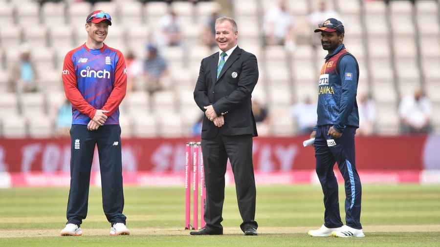 Phil Whitticase with the captains at the toss for the third T20I AFP/Getty Images