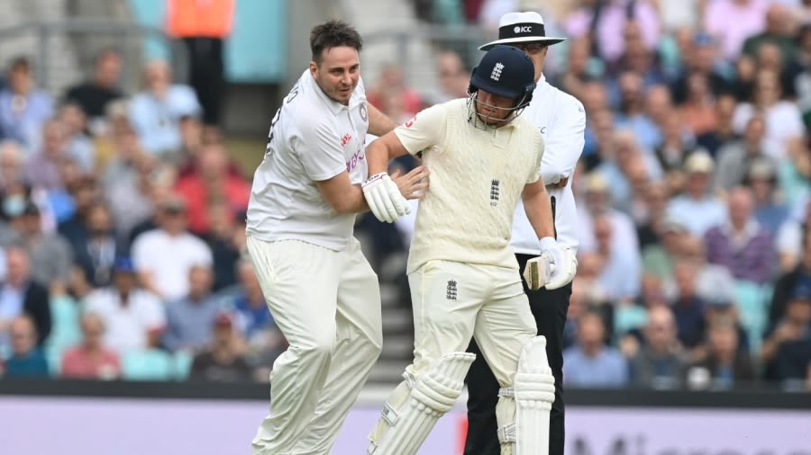 Pitch invader Jarvo collides with Jonny Bairstow AFP/Getty Images
